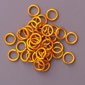 "100 ct. 18 ga Gold Anodized Aluminum 7/32"" Links"